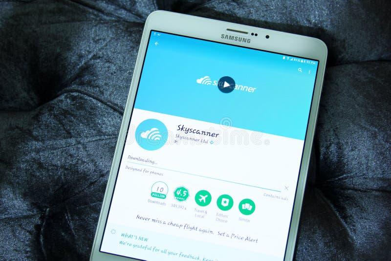 Skyscanner loty, hotele, samochody rezerwuje wiszącą ozdobę app obraz royalty free