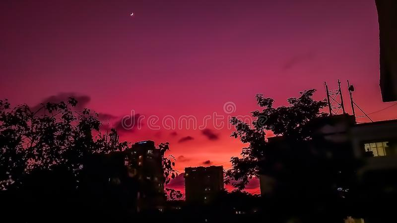 Skyscape and beautiful sky with gradient of colours and tiny moon royalty free stock photo