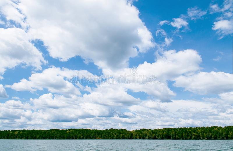 Skyscape blue summer sky with white clouds and tropical mangrove royalty free stock image