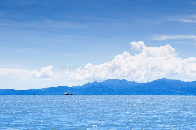 Skyscape blue summer sky with white clouds and tropical seascape royalty free stock images