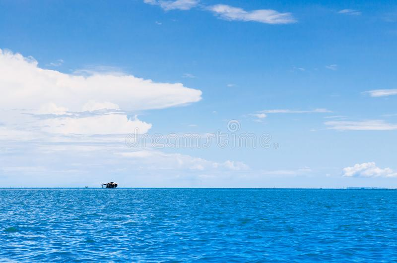 Skyscape blue summer sky with white clouds and tropical seascape stock image