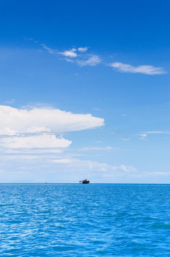 Skyscape blue summer sky with white clouds and tropical seascape stock photography