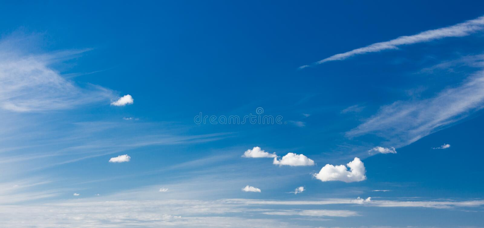 Skyscape. Deep blue sky with white clouds as nature background royalty free stock photography