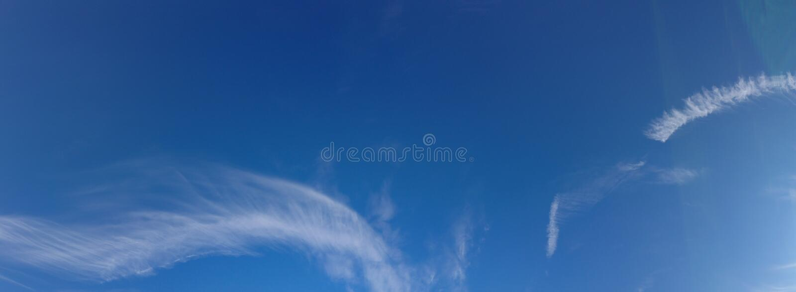 Skyscape blue sky and clouds. A skyscape with summer blue sky and clouds royalty free stock photography