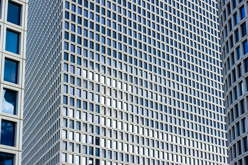 Skyscraper building modern city architecture exterior facade wall and windows background. Urban landmark wallpaper view, copy space stock photos