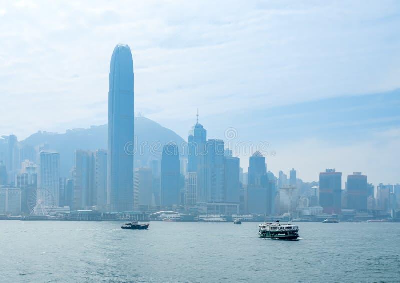 Skyscraper buildings at Victoria harbor, Hong Kong. HONG KONG, CHINA - JANUARY 20 : Landmark skyscraper buildings at Victoria harbor with daylight mist, Hong royalty free stock photography