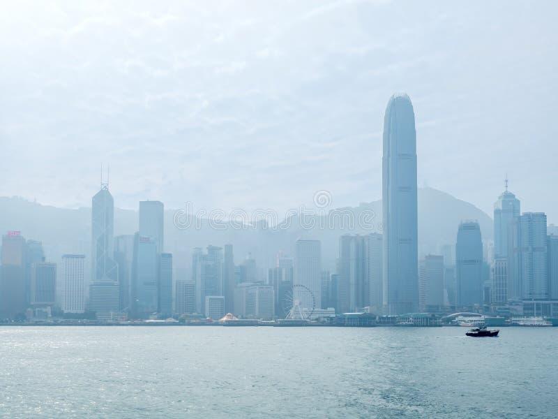 Skyscraper buildings at Victoria harbor, Hong Kong. HONG KONG, CHINA - JANUARY 20 : Landmark skyscraper buildings at Victoria harbor with daylight mist, Hong royalty free stock photos