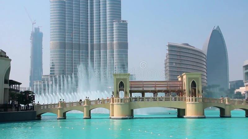 Skyscraper Burj Khalifa and singing fountains in Dubai, United Arab Emirates. Burj Khalifa known as Burj Dubai prior to its inauguration is a skyscraper in Dubai stock video footage
