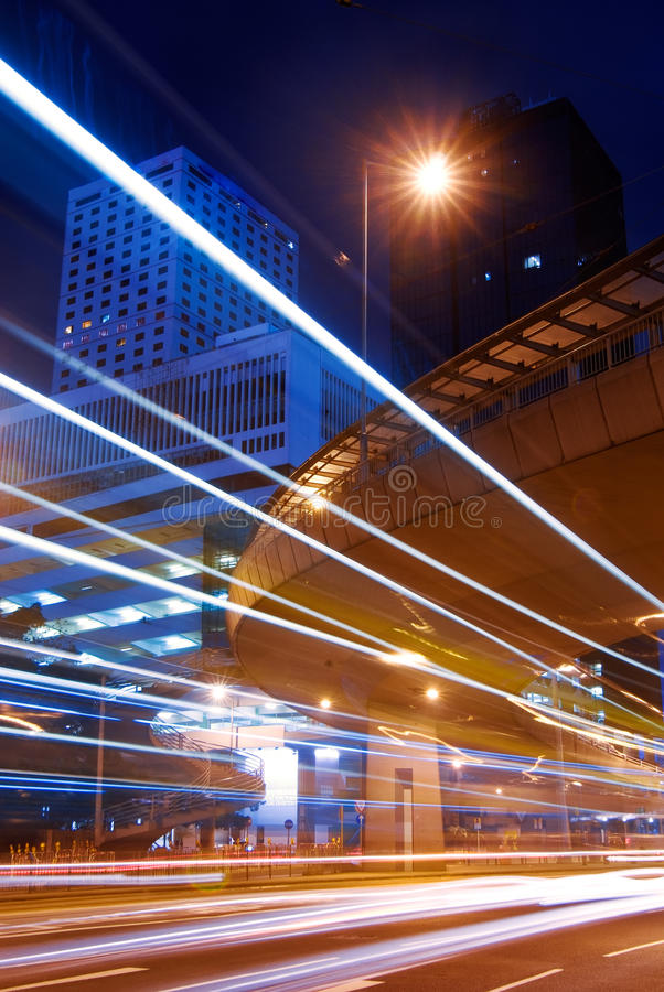 Skyscraper with cars motion blurred light stock image