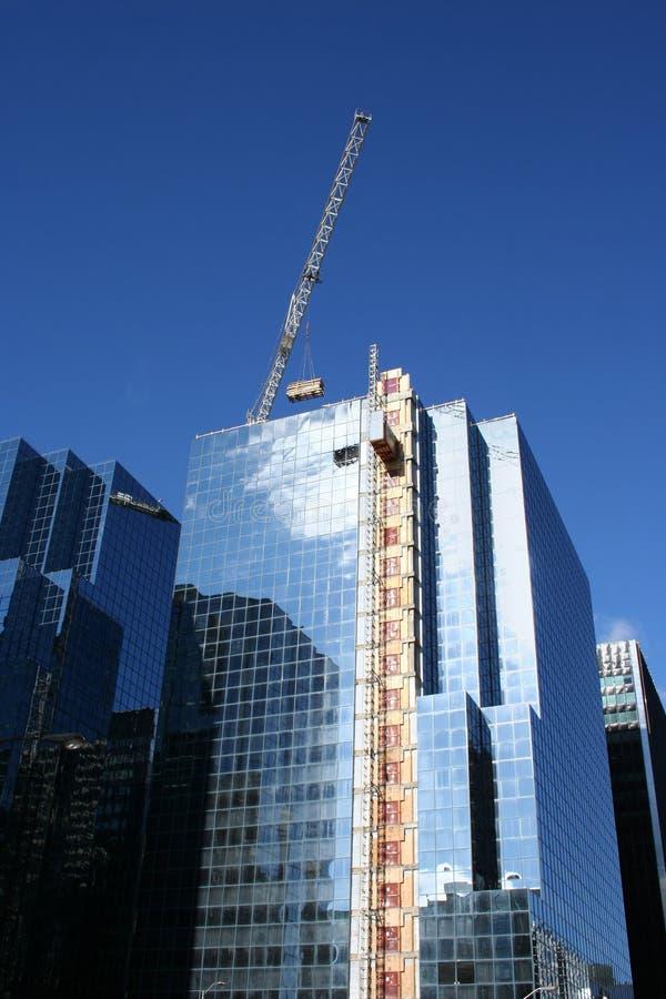Skyscraper construction crane stock image