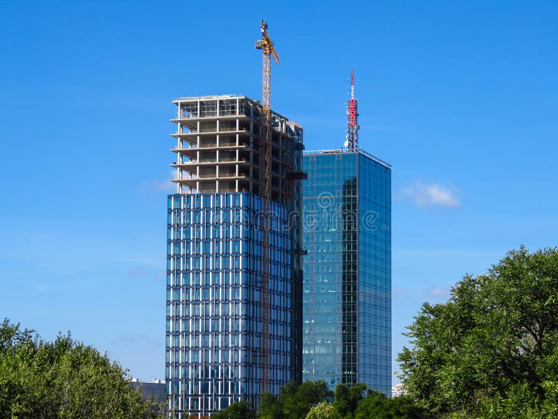 Skyscraper construction site. Finishing of the second tower USCE 2. royalty free stock photo