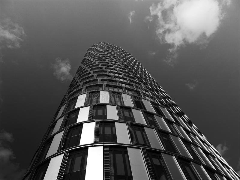 Skyscraper with curved facade stock images