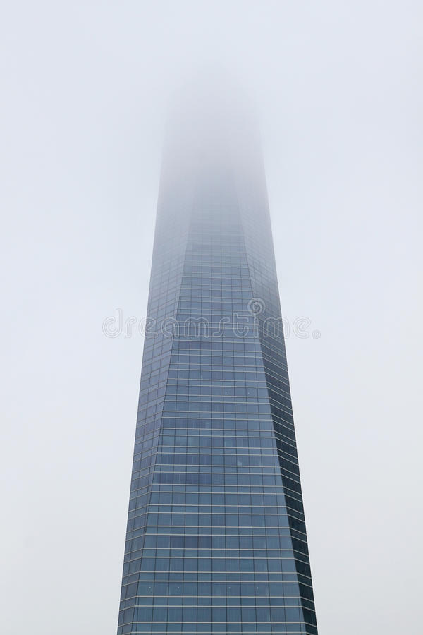 Download Skyscraper Day In A Haze Of Fog. Stock Photo - Image: 28500058