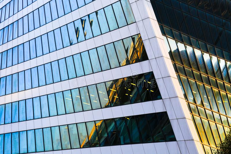 Skyscraper exterior design. Abstract view of window, mirror reflection and detail architecture close-up. Modern office building. stock photos