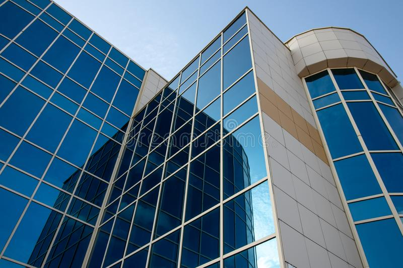 Skyscraper of glass, modern office buildings. High-rise building with reflection window. Facade of business center. Financial down royalty free stock photos