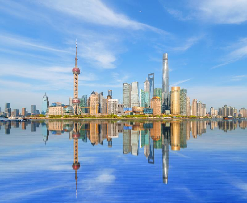 Skyscraper and high-rise office buildings with reflection in Shanghai Downtown with blue sky, China. Financial district and stock photos