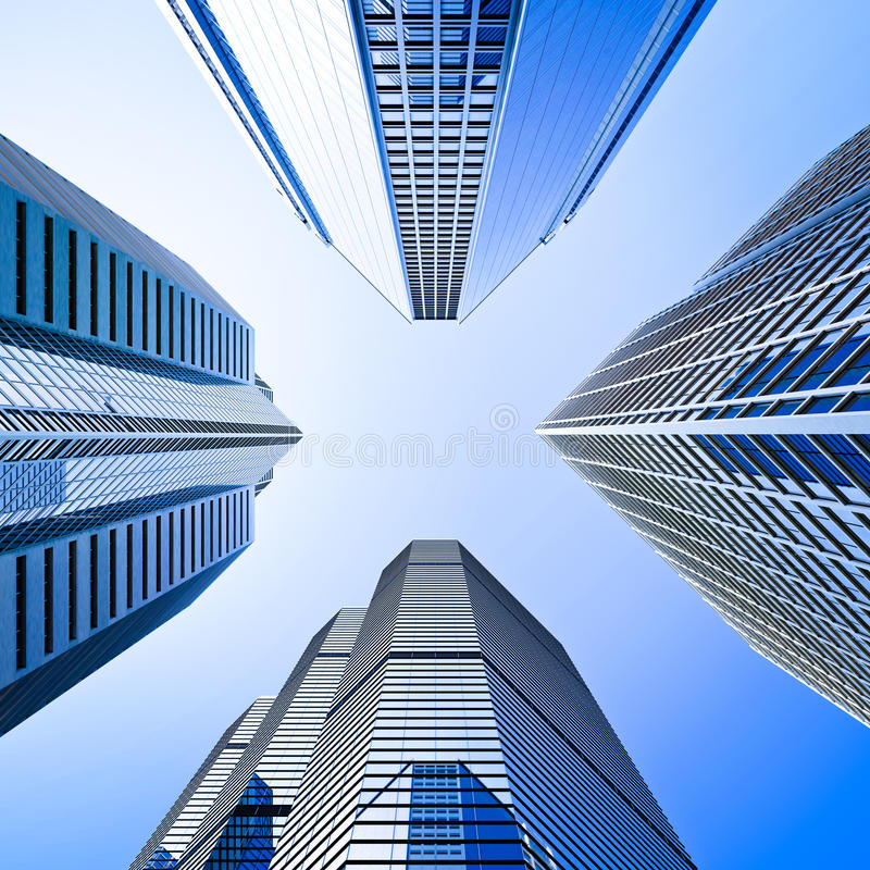 Blue Highrise Glass Skyscraper Intersection Low Angle Shot: Skyscraper Intersection Low Angle Shot Stock Image