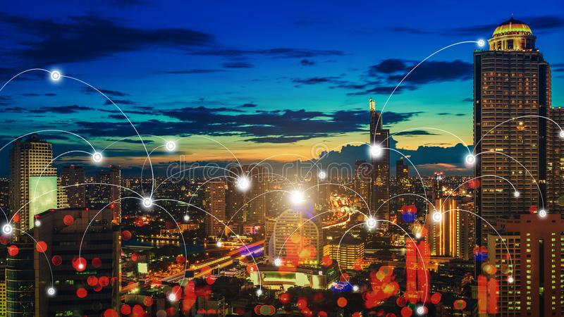 Skyscraper night city with connection icons. Smart communication. In city royalty free stock image