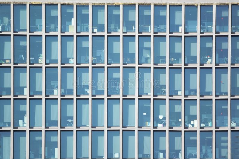 Skyscraper office building facade. Blue tone frame background and empty copy space stock photography