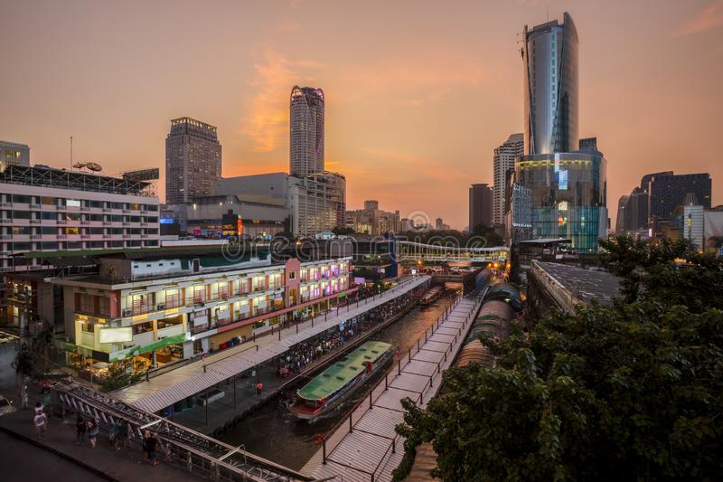 Skyscraper and Pratunam pier in Bangkok; water transportation by speed boat is one of the alternative choice for solving the. Traffic congestion problem in stock image