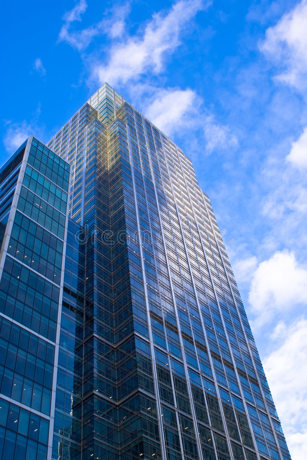 Skyscraper reflecting sky stock photos