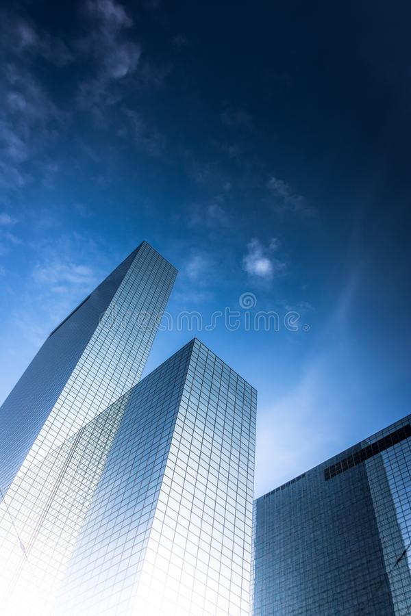 Skyscraper rising from sun reflection. In a bright blue sky royalty free stock photos