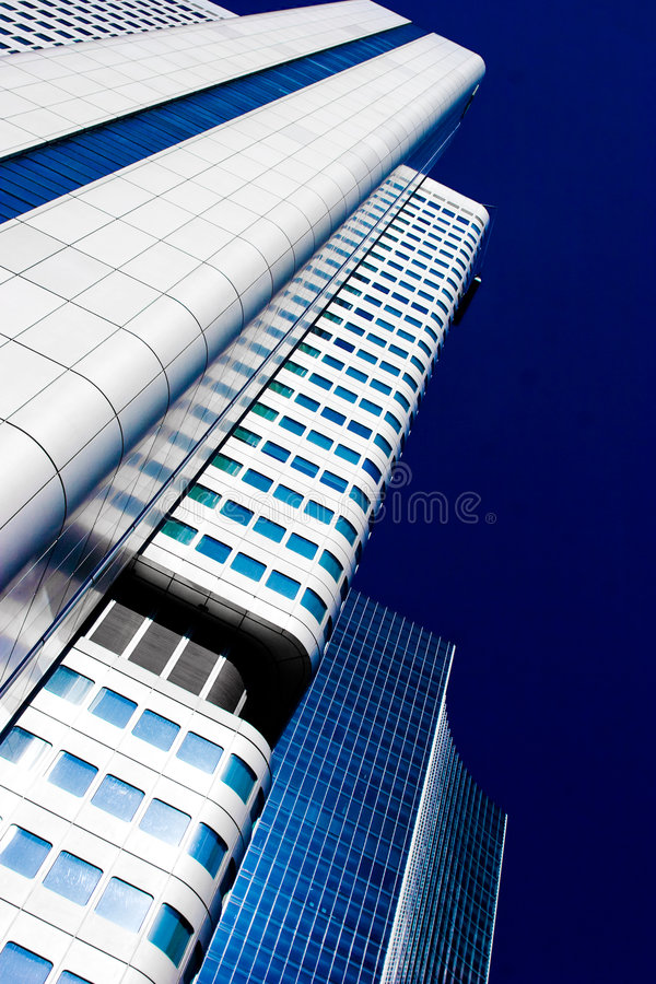 Free Skyscraper Vanishing In Blue Sky Royalty Free Stock Image - 6048676