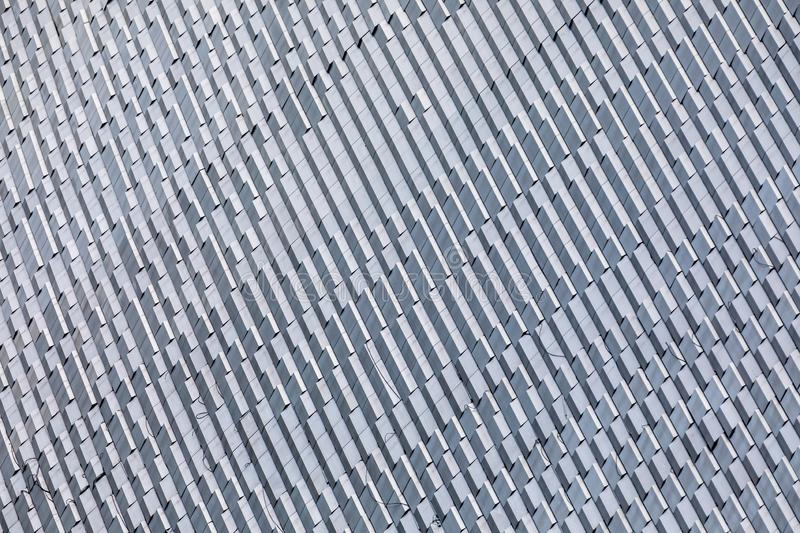 Skyscraper wall abstract background with repeated rectangular cells stock image