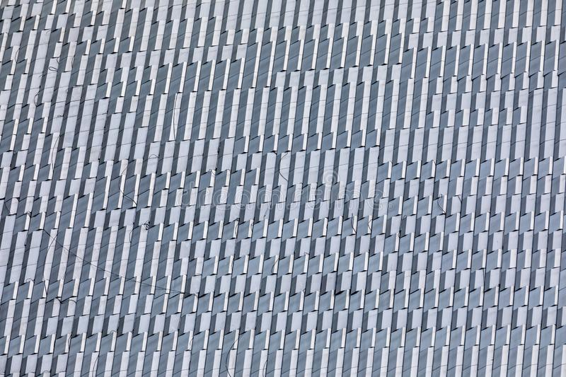 Skyscraper wall abstract background with repeated rectangular cells stock photo