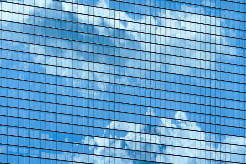 Skyscraper windows with clouds reflection royalty free stock image
