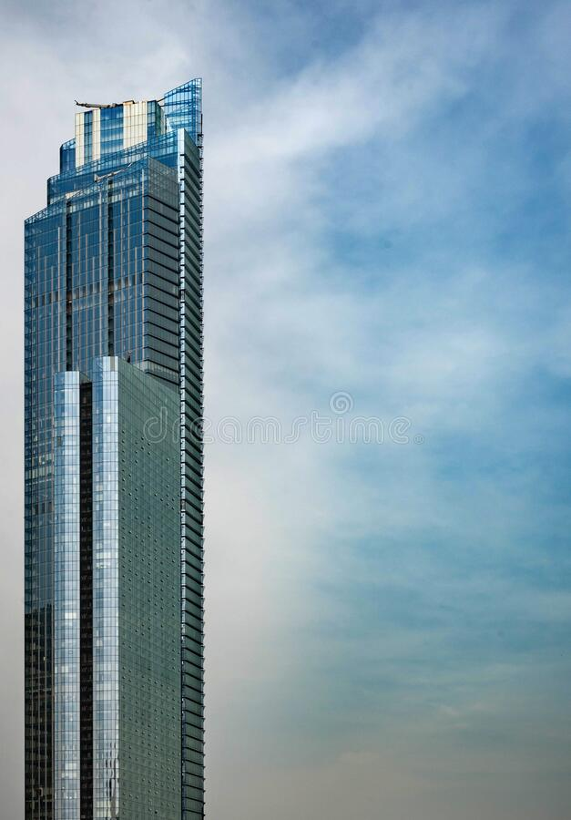 Free Skyscraper With Blue Sky And White Clouds Royalty Free Stock Photo - 177715345