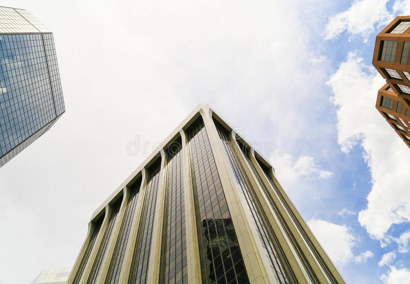 Skyscrapers of Denver. Denver, USA - May 25, 2016: Looking up a skyscraper belonging to the World Trade Center and the Colorado State Bank and Trust building in royalty free stock photography