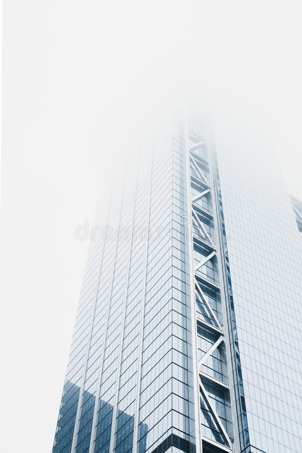 Skyscrapers disappear in the fog in New York, USA. New York is one of the most visited cities in the world royalty free stock image