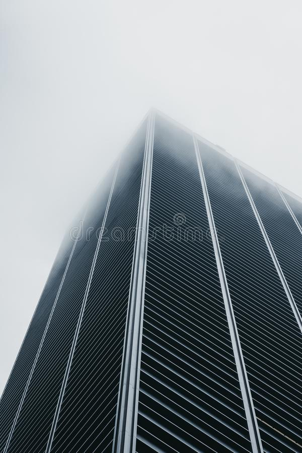 Skyscrapers disappear in the fog in New York, USA. New York, USA - June 1, 2018: Skyscrapers disappear in the fog in New York, USA. New York is one of the most royalty free stock image