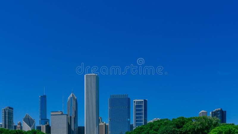 Skyscrapers of downtown Chicago, USA under blue sky stock photography