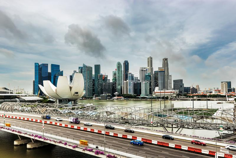 Skyscrapers in downtown city of Singapore. Singapore - Jan 11, 2018: Futuristic architecture of Helix bridge walkway, flower shape design of the Art Science stock photo