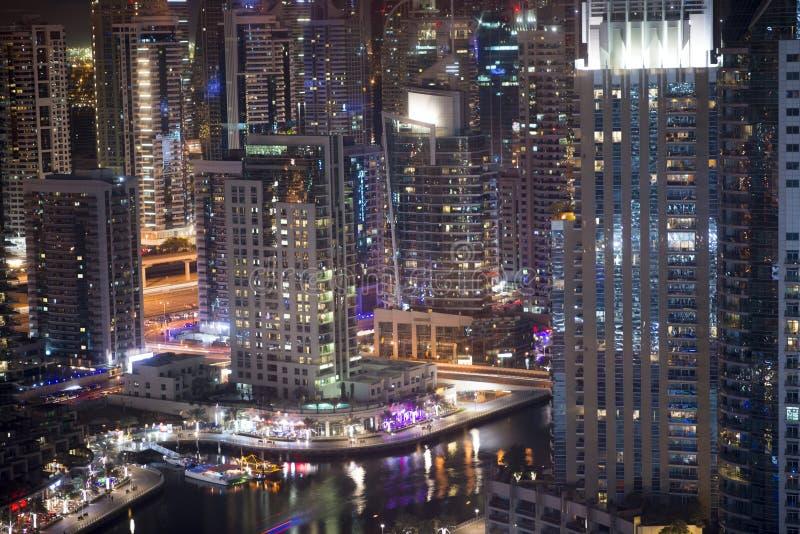 Skyscrapers in Dubai Marina by night, Dubai, United Arab Emirates stock photos