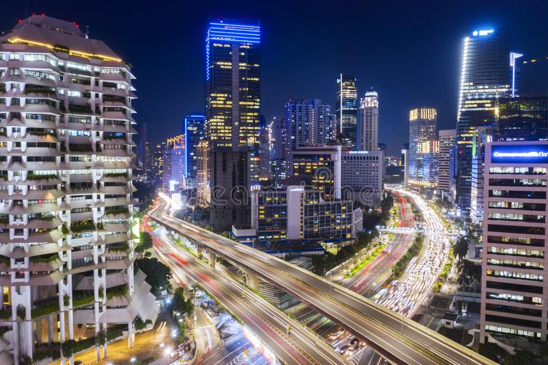 Skyscrapers with hectic traffic at night time. JAKARTA - Indonesia. January 23, 2019: Aerial view of skyscrapers with hectic traffic at night time in South royalty free stock photo