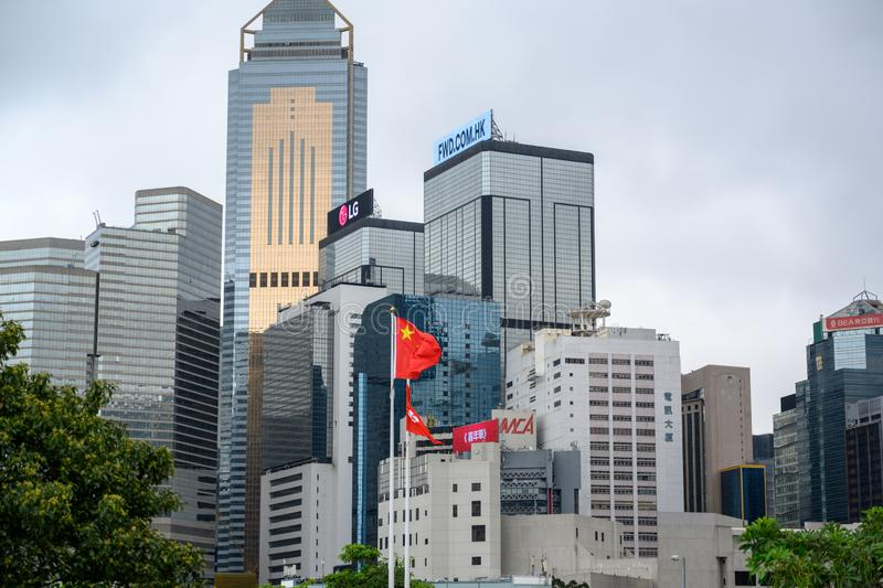 Skyscrapers and high rise buildings of international companies with chinese flag in front in Hong Kong Island, China stock images
