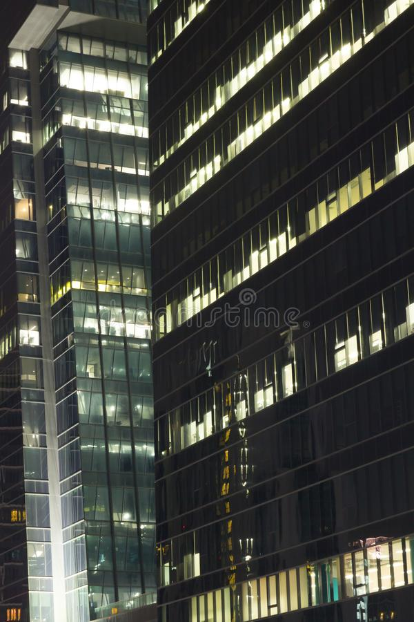 Skyscrapers with lights on the offices by night, Bangkok , Thailand royalty free stock image