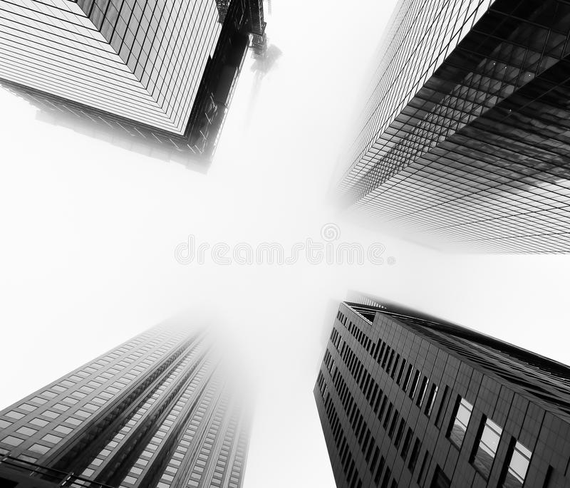 Skyscrapers during low-lying clouds and fog in Toronto. TORONTO, CANADA - 24TH DECEMBER 2014: A low view of skyscrapers in downtown Toronto during a day when the stock photos