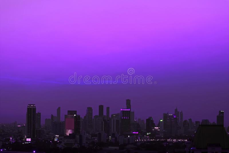 Skyscrapers of the Metropolitan Area under Vivid Purple Evening Sky. Beautiful background aerial architecture asia blue building buildings business capital royalty free stock photos