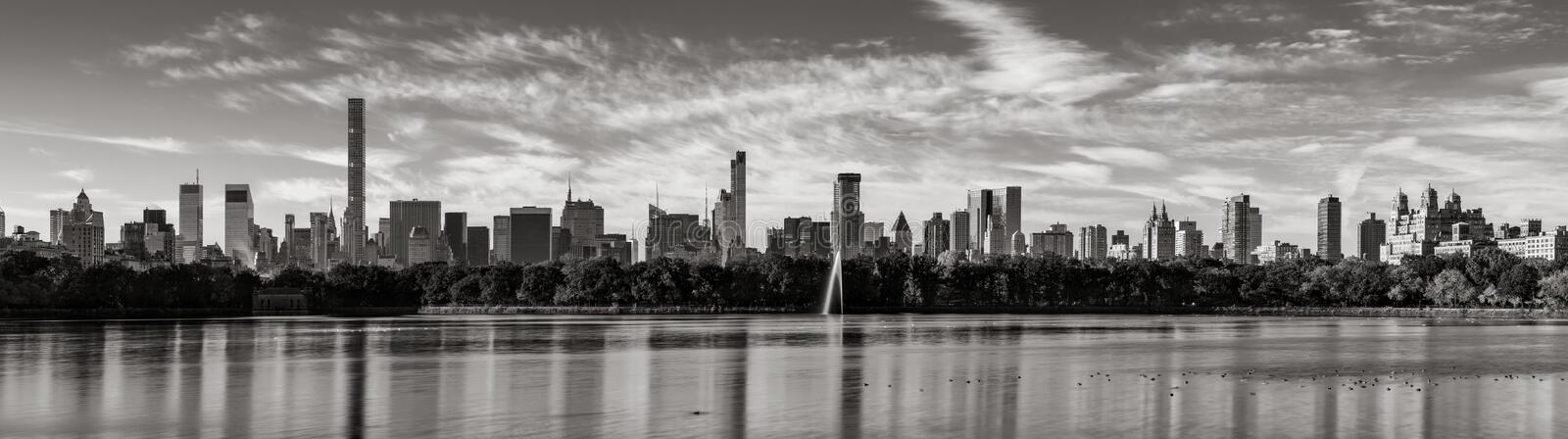 Skyscrapers of Midtown Manhattan and Central Park Reservoir in Black & White. New York City royalty free stock images