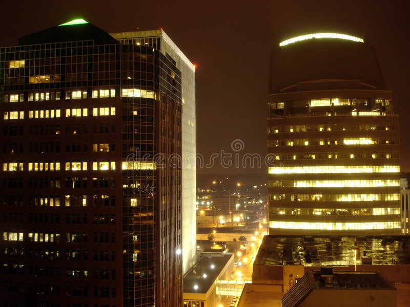 Skyscrapers in the night stock images