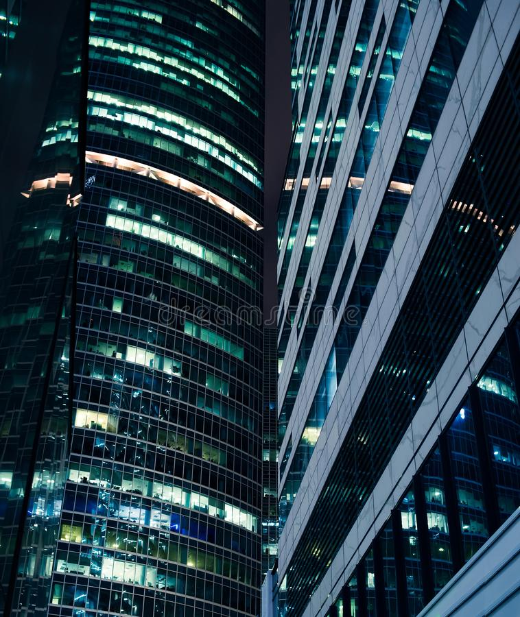 Skyscrapers at night, abstract background. Financial center. Technology stock image