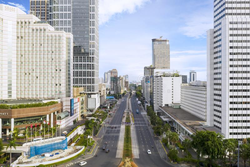 Skyscrapers with quiet Thamrin road in Jakarta city royalty free stock images
