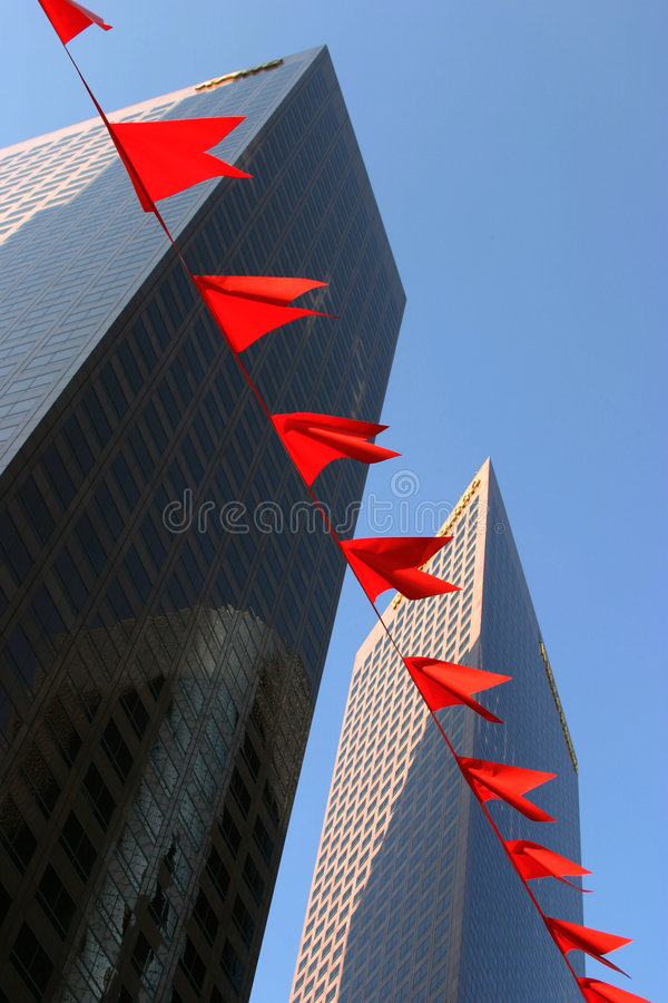 Skyscrapers and red flags royalty free stock images