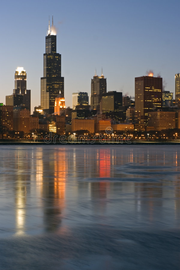 Skyscrapers reflected in icy Lake Michigan royalty free stock photography