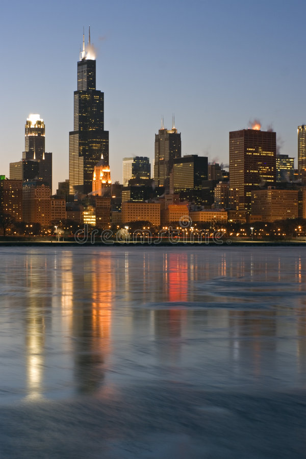 Skyscrapers reflected in icy Lake Michigan stock photos