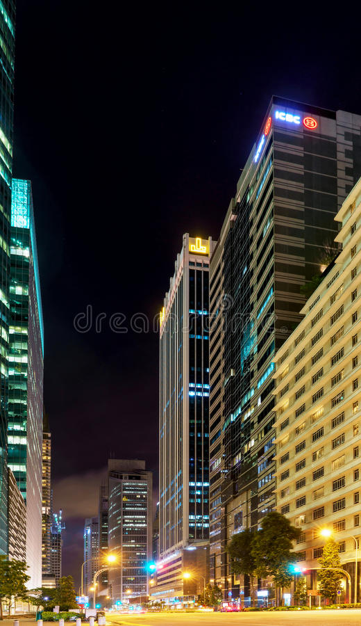 Skyscrapers and road in center of in Singapore at night royalty free stock photography